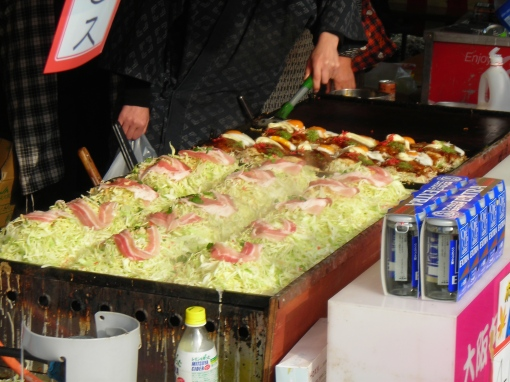 I think these are a type of okonomiyaki (a sort of pancake filled with various vegetables and seafood) but I've never seen them made entirely of lettuce like that.